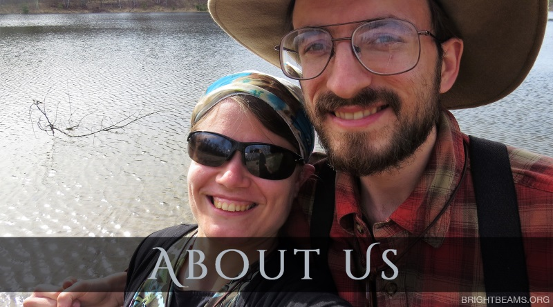 About Us - Ricky and Amanda Bokovoy by a lake