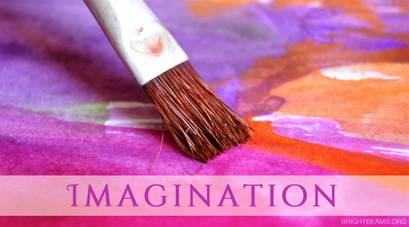 Imagination - A paintbrush spreading colourful paint on a canvas