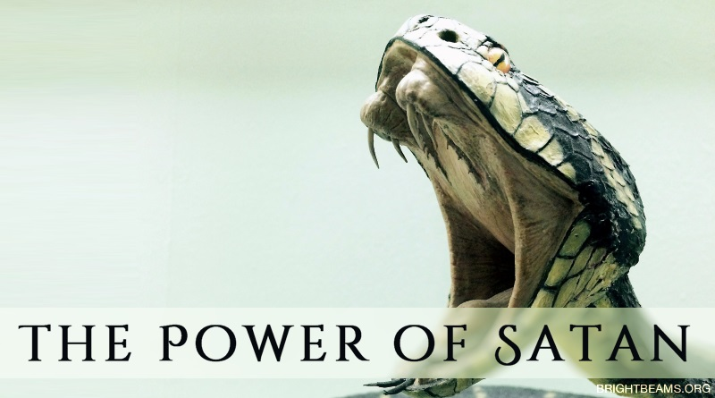 The Power of Satan - a snake baring its fangs